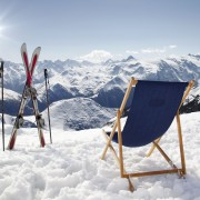 Cross ski and Empty sun-lounger at mountains in winter, France High mountain